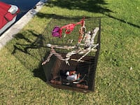 black and red metal pet cage Saint-Zotique, J0P 1Z0
