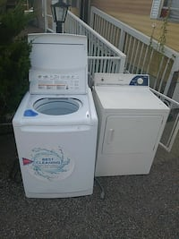 two white clothes washers