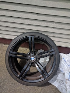 black BMW 5 spoke car wheel with Hankook tire