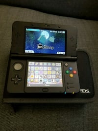 black Nintendo DS with game cartridge Vaughan, L4H