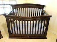 brown wooden crib bed