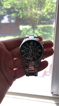 round black chronograph watch with silver link bracelet Baltimore, 21212