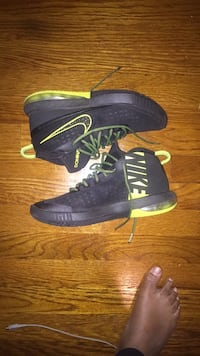 pair of black-and-green Nike basketball shoes District Heights, 20747