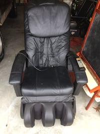 Black leather massage chair. Price is negotiable.