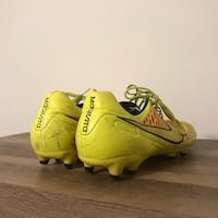 pair of yellow-and-black Nike cleats Alexandria, 22311