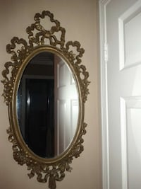 oval brown framed wall mounted mirror Mississauga, L5M 7P2