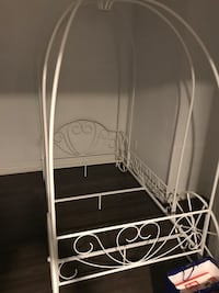 Unqiue Metal Twin Carriage Bed.