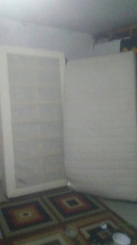 Singel white mattresses and box spring with legs
