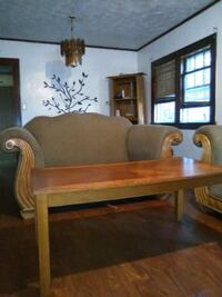 Couches and table and curio cabinet with light Rockford