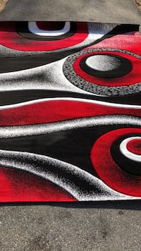 Red, white, and black area rug