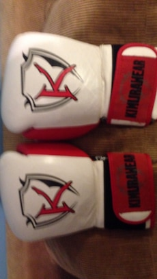 pair of white-and-red training gloves