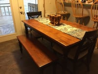 Rectangular brown wooden dining room table