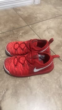 pair of red Nike running shoes Tucson, 85756