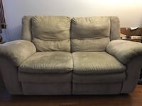 Beige reclining sofa and reclining loveseat. New York, 10301