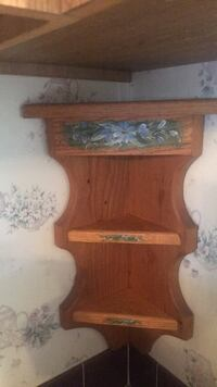 cute  wooden shelf  with flower designs  . It has 3 shelves and  can fit in a corner ...  Charles Town, 25414