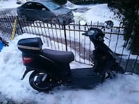 black and gray motor scooter