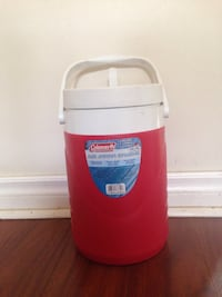 White and red Coleman insulated water jug
