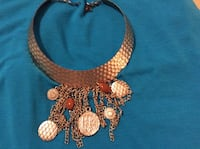 Gold-colored hammered look dangle necklace. Lexington, 40517