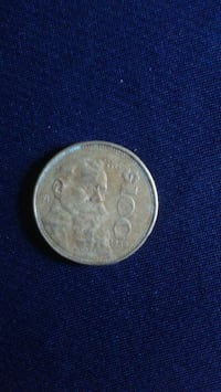 round silver-colored coin Louisville
