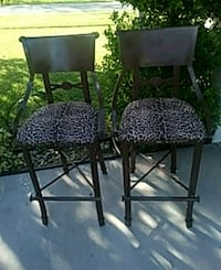 two black metal framed padded chairs 832 mi