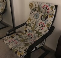white and black floral padded armchair