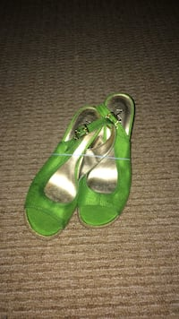 pair of green leather open-toe heeled sandals