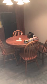 Table and 4 chairs. Must pick up. Obo