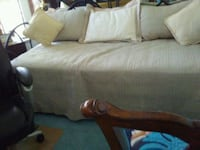 Daybed black iron trundle. Comes with new matterresses, spread, shams