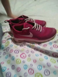 Pink nikes in new condition Lubbock, 79423