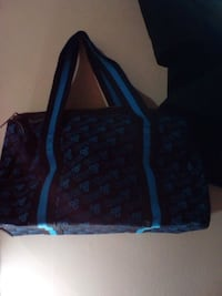 women's black and blue tote bag