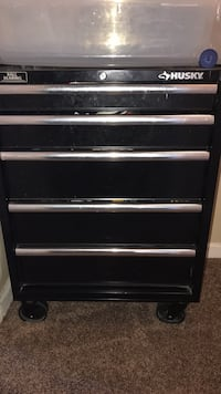 black and gray metal tool chest