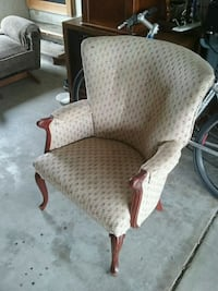 brown wooden framed gray padded armchair 487 mi