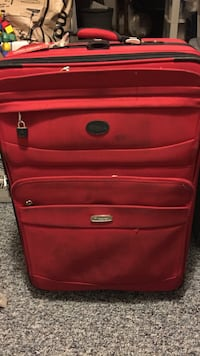 red soft-side luggage