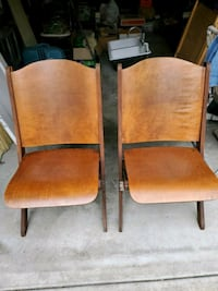 2 wood folding chairs from a church