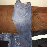 two blue and one black denim jeans Grande Prairie, T8V 7W4