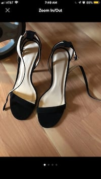 Pair of black leather open-toe ankle strap heels 44 km