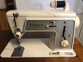 White and gray singer sewing machine