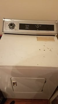 white Whirlpool front-load clothes dryer