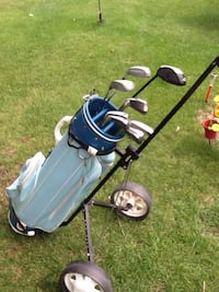 Blue and black golf bag with golf clubs .Ladies right handed.  (18)