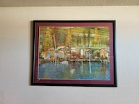 red wooden framed painting