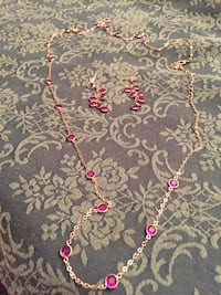 Gold chain necklace with dark pink accents with earrings