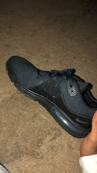 pair of black Nike running shoes Quincy, 02169