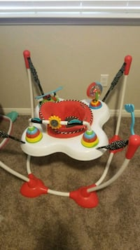 white, red, and green jumperoo Leander, 78641