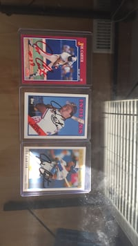 Joe Carter signed baseball cards.