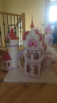 white and pink castle toy