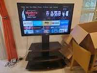 TV with stand and Free Fire TV Stick Germantown, 20876
