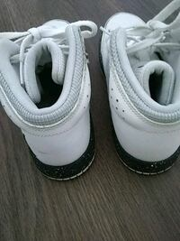 pair of white Nike low-top sneakers Mississauga, L5B