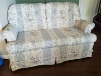 white and gray floral suede padded loveseat