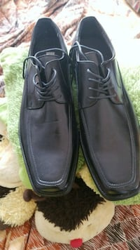 pair of black leather dress shoes Montreal, H3R 3L4