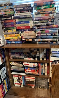 FREE VHS tapes and cabinet.  Must take all. Skokie, 60076